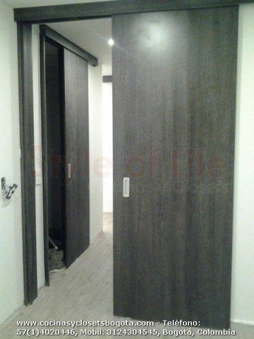 Puertas en madera puertas de seguridad bogota puertas for Modelos de puertas corredizas de madera